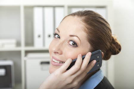 Friendly Helpdesk Assistant makes phone call support 版權商用圖片