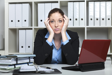 file clerks: Tired businesslady looks desperate Stock Photo