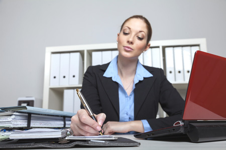 front desk: Front Desk Lady writes an appointment to her schedule