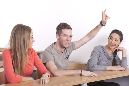 sorority: Nerd sits between two female students and puts up his hand
