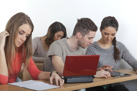 exempted female: Student looks to what his collegue explains him on the tablet