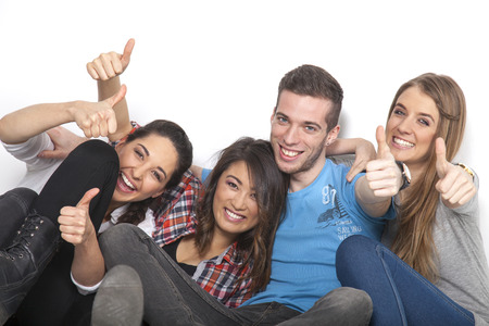 abi: Four students hold up their hands with thumbs up Stock Photo