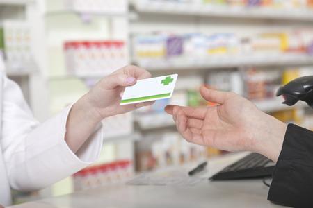 Customer hands over her payment customer card Foto de archivo