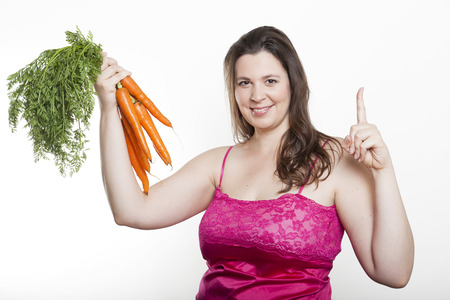 forefinger: Woman holding a bunch of carrots and their forefinger