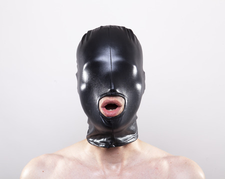 slave: Man wearing mask without openings for his eyes