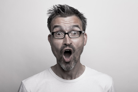 Portrait of an enthusiastic man with glasses and stubbly beard