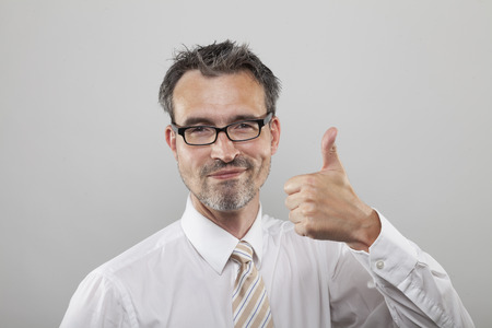 smartly: Smartly smiling office clerk holds his thumb up