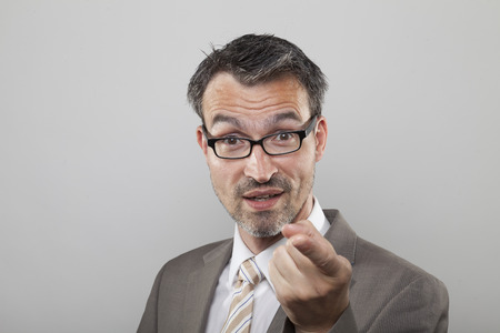 argues: Determinated business man with stubble argues by pointing his forefinger