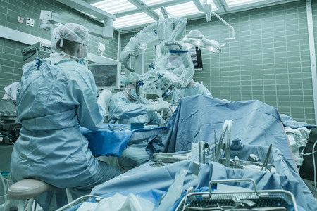 critical care: Brain surgery using surgical microscope in a neurosurgical operating room