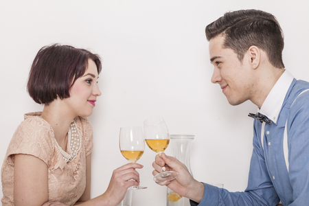 couple having wine and coffee in a cafeteria fall in love Stock Photo
