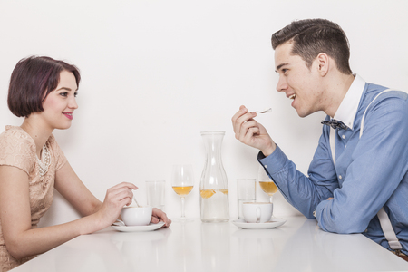 Blind Date: couple having wine and coffee in a cafeteria fall in love Stock Photo