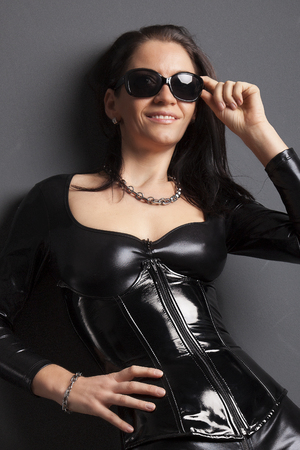woman in shiny latex rubber corset and spandex catsuit Stock Photo