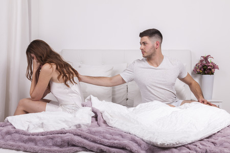 impotent: woman in bed desperately confessed her cheating. man tries to calm her