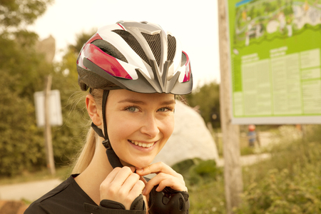 portrait of a blond woman with skating protection helmet Stock Photo