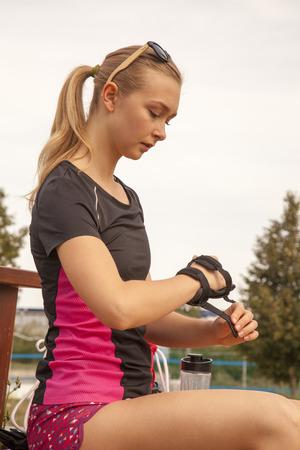 teenage girl prepares for running on inline skates