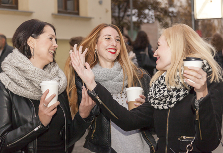 girlfriends have a lot of fun after work chatting gossip and laughing Stock Photo