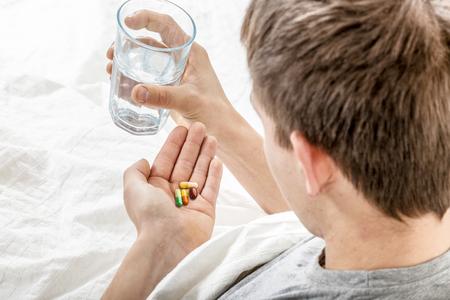 Man takes tablets