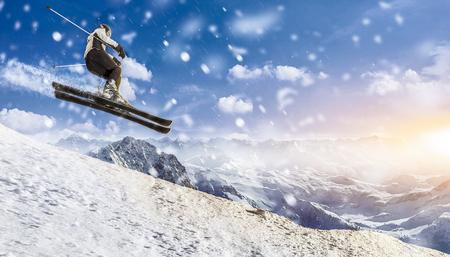 skier jumps downhill through the air