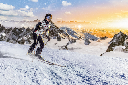 female skier rides downhill on her allround carver skis