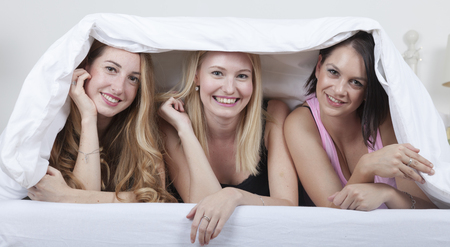 three best friends under the coverlet Stock Photo