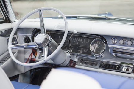 interior of a historic american veteran car with ivory steering wheel and gear shift