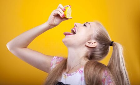 blond woman strengthen immune system drinking fresh lemon juice Banco de Imagens