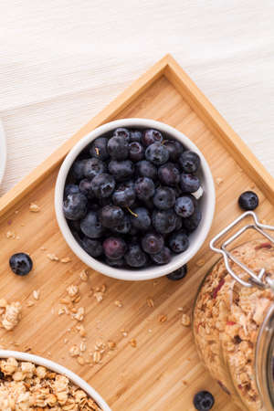 top view food photography detail of fresh blue berries blueberries in a low bowl saucer stand on the table Stock Photo