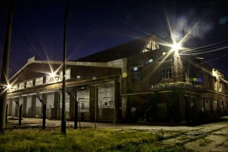depot: Shabby looking train depot shot at night.