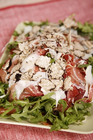 A meat salad, with chicken, bacon, prosciutto, lettuce and a lot of tasty and delicious spices. Stock Photo