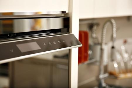 Close-up of dishwasher in modern kitchen.