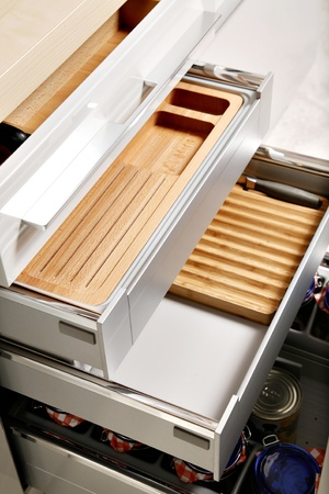 drawers: Modern kitchen drawers with compartments for various things.