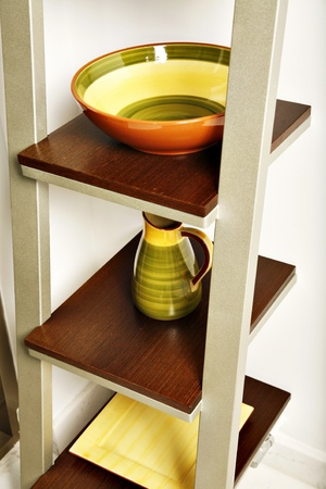 Simple kitchen shelves with colorful pottery.