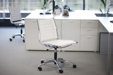 Two chairs and desks inside an office building. Stock Photo