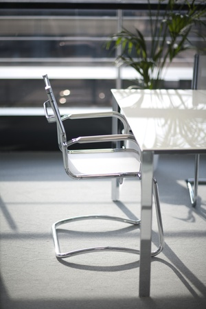 A chair and a table in an office building.