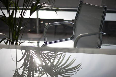 A reflection on an office table, in a business space. Stock Photo