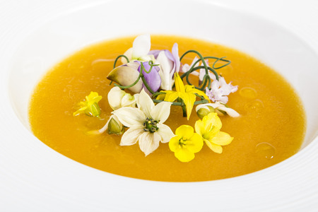 upscale: Delicious pumpkin soup with beautiful  flowers inside