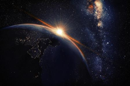 宇宙から見た映画と非常に現実的な日の出 写真素材