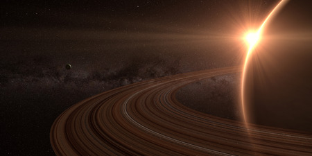 saturn rings: planet saturn with rings at sunrise on the space background Stock Photo