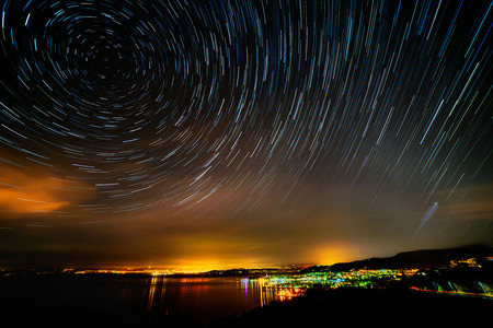 north star: beautiful sky at night over izola with startrails Stock Photo