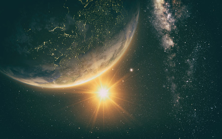 backgroud: earth with Sunrise from space with milkyway in the backgroud
