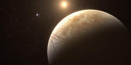 A rendered Image of the Jupiter Moon Europa on a starry background. Foto de archivo
