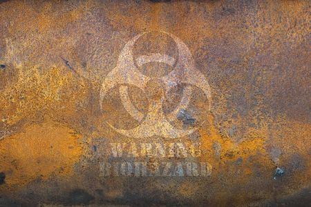 containment: Rusting tank with biohazard warning Stock Photo