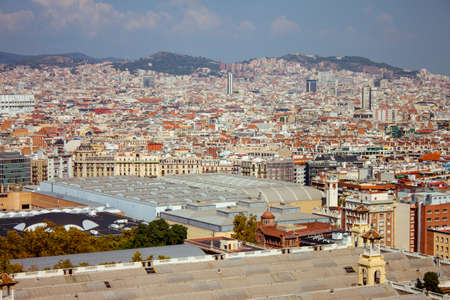 Panoramic view of sunny Barcelona in Spain. Roofs of the houses and mountains. High quality photo
