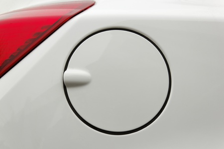 A close up of a petrol cap cover on a modern white car Stock Photo