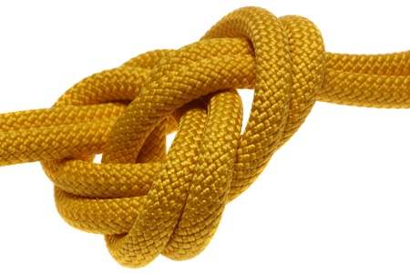 apocryphal knot on double yellow rope. isolated on white background Stock Photo
