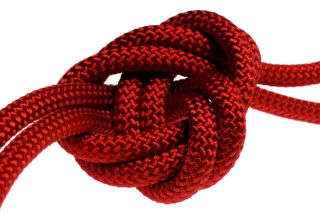 apocryphal knot on double red rope. isolated on white background photo
