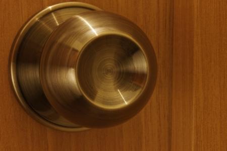 The handle on whooden door Stock Photo - 13691520