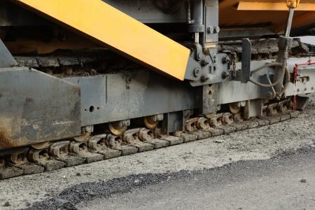 durty: cliseup of aspahlt paving machines track