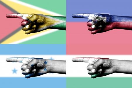 set of pointing finger in national flags of  Hungary, Guyana, Haiti and Honduras Stock Photo - 14061447