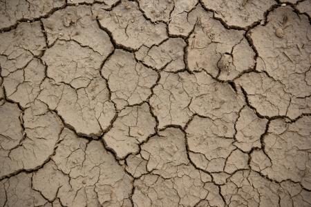 cracked clay ground into the dry season Stock Photo